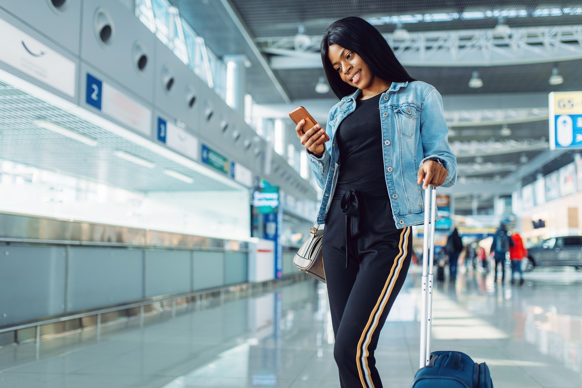 black-female-tourist-in-international-airport-395M4YK
